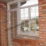 Окна и двери в частном доме.Балконный блок - выход на балкон. Раскладка уравнена