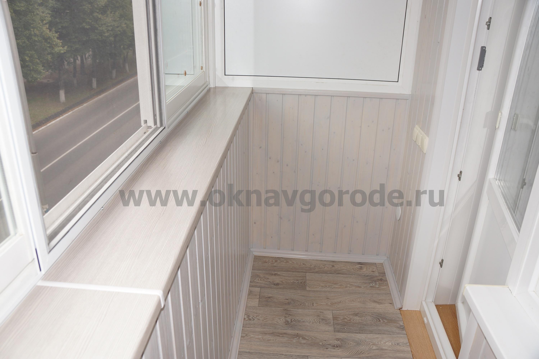 otdelka-balkonov-v-kurske-foto-i-tseny-razdvizhnoj-pvh-balkon